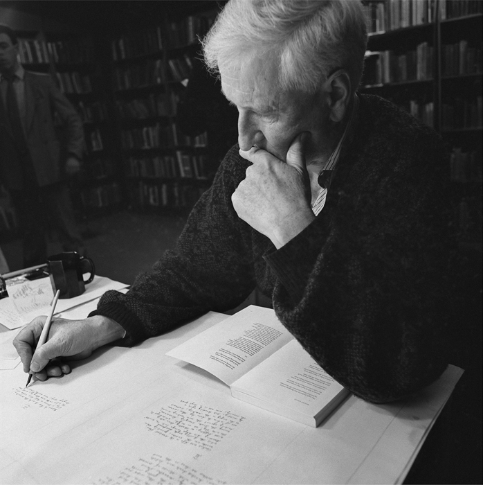 The poet John Montague at work.