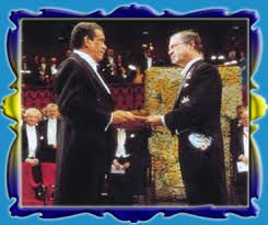 Derek Walcott receives his Nobel Prize for Literature from the King of Sweden King Karl XVII Gustaff - in December 1992.