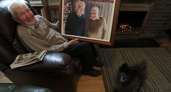 Barney Devlin (95) with a prized painting of himself and Seamus Heaney. His father is the blacksmith referred to by Heaney in The Forge.