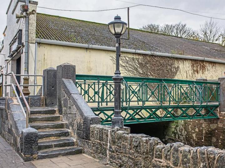 GN4_DAT_9088199.jpg--the_restored_151_year_old_bridge_which_has_been_reopened_to_pedestrians_in_the_county_town__below__the_footbridge_as_seen_in_a_national_library_of_ireland_photograph