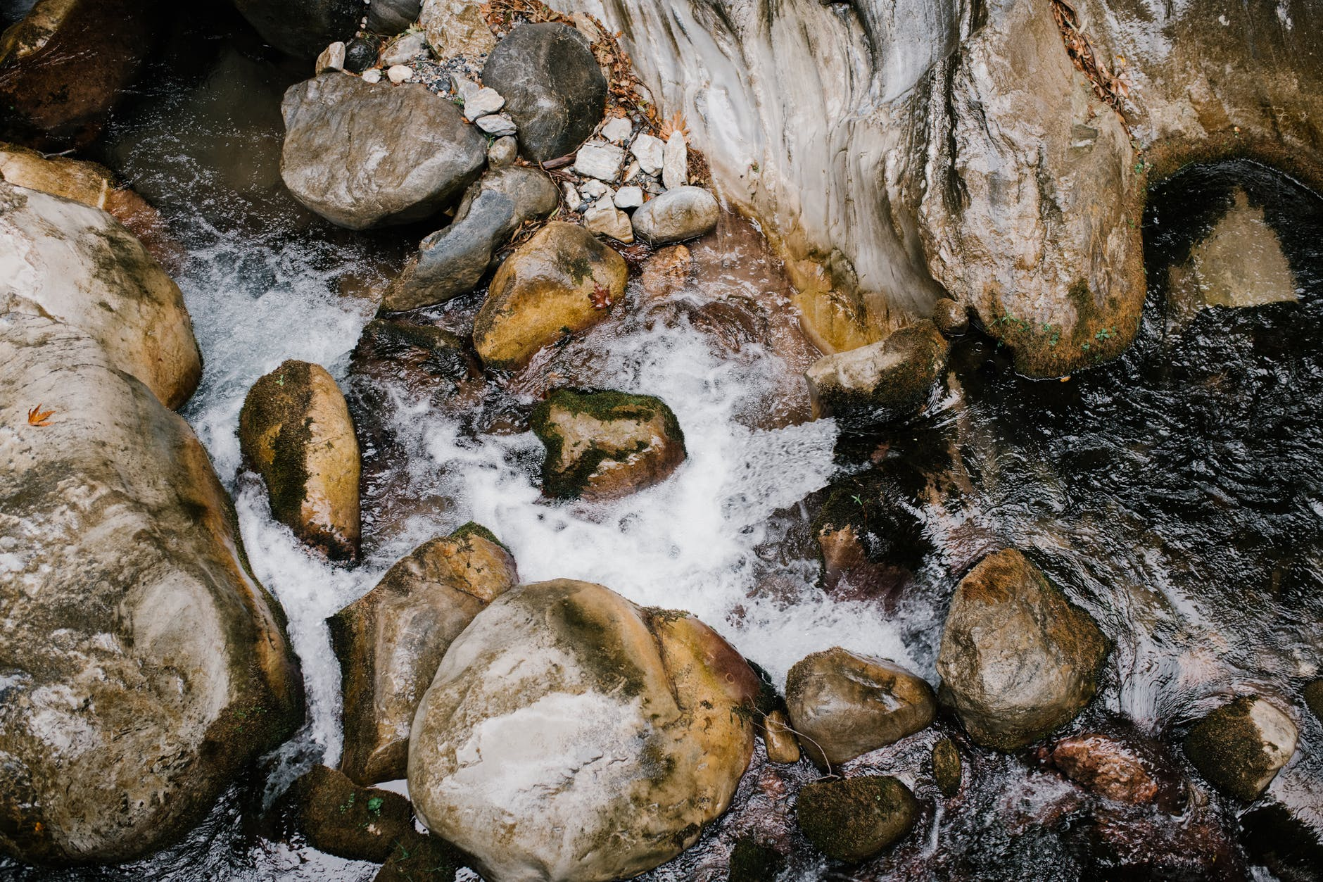 shiny boulders and water stream